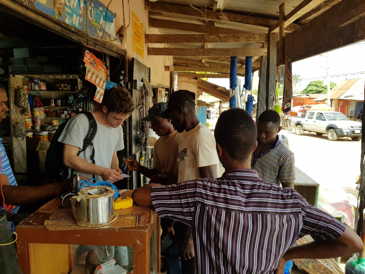 Alex and Donkorkrom workers buying supplies