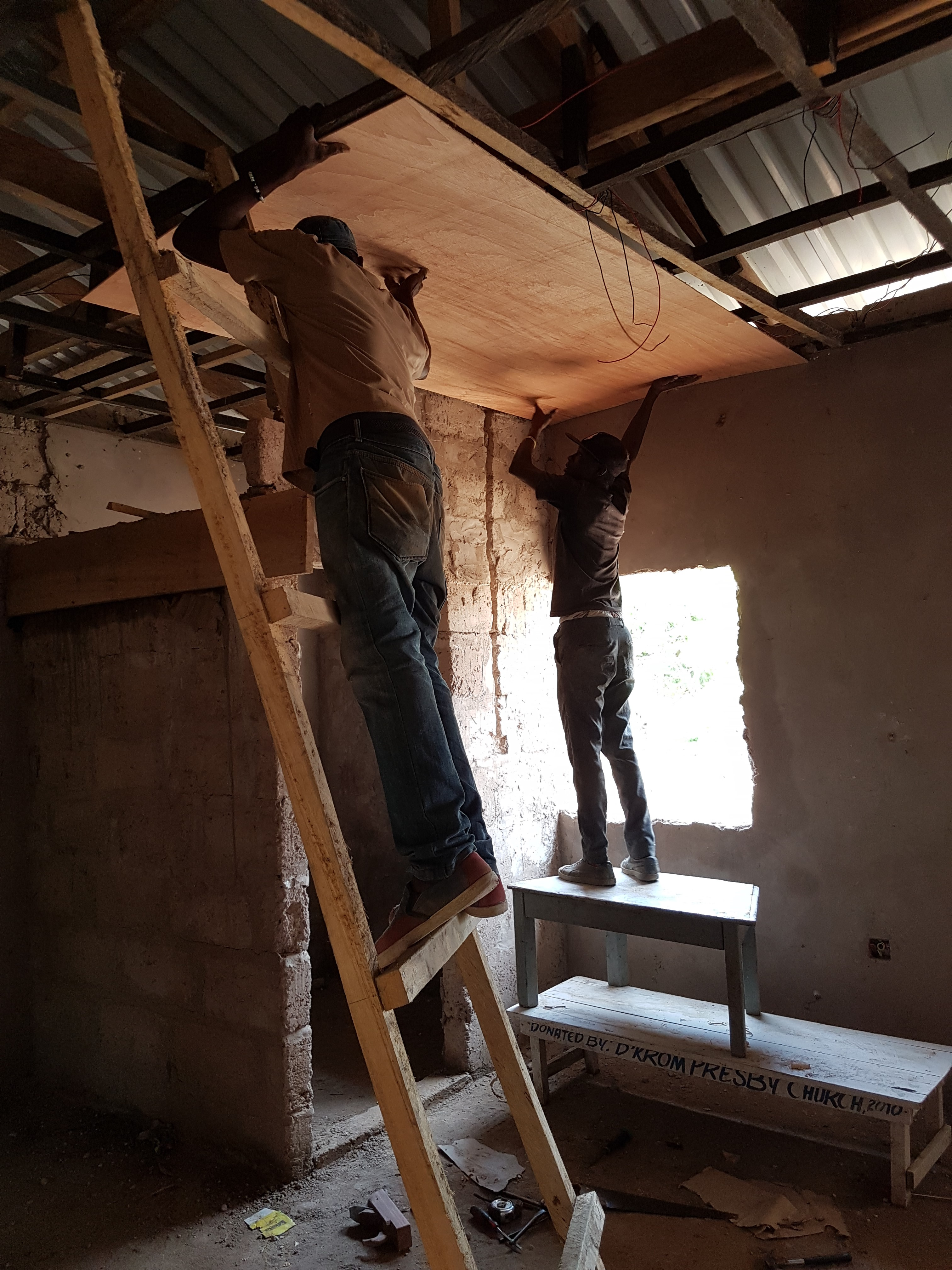 Captain and Davido installing privat room ceiling