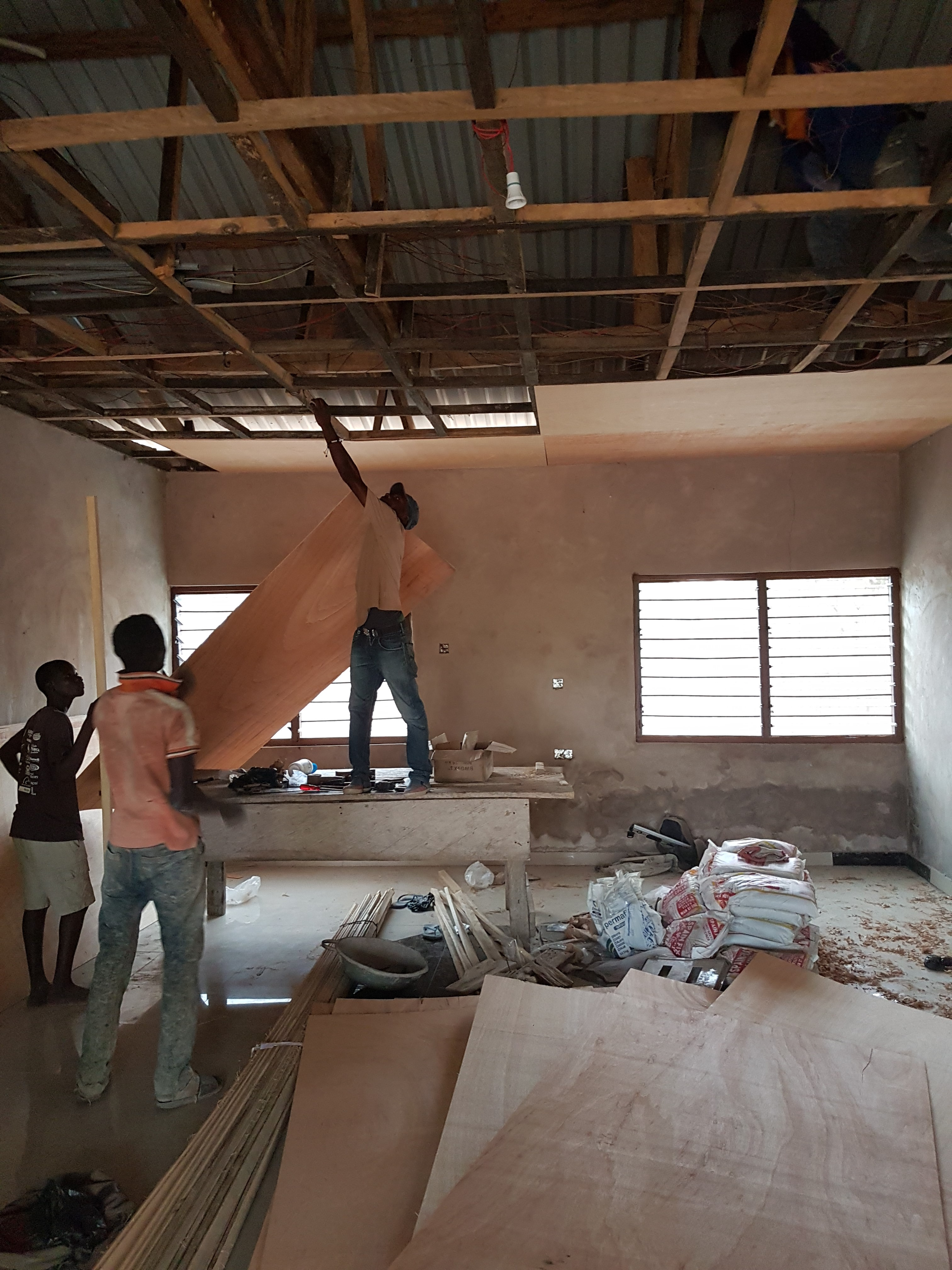 Installation of main hall ceiling at donkorkrom orphanage guesthouse