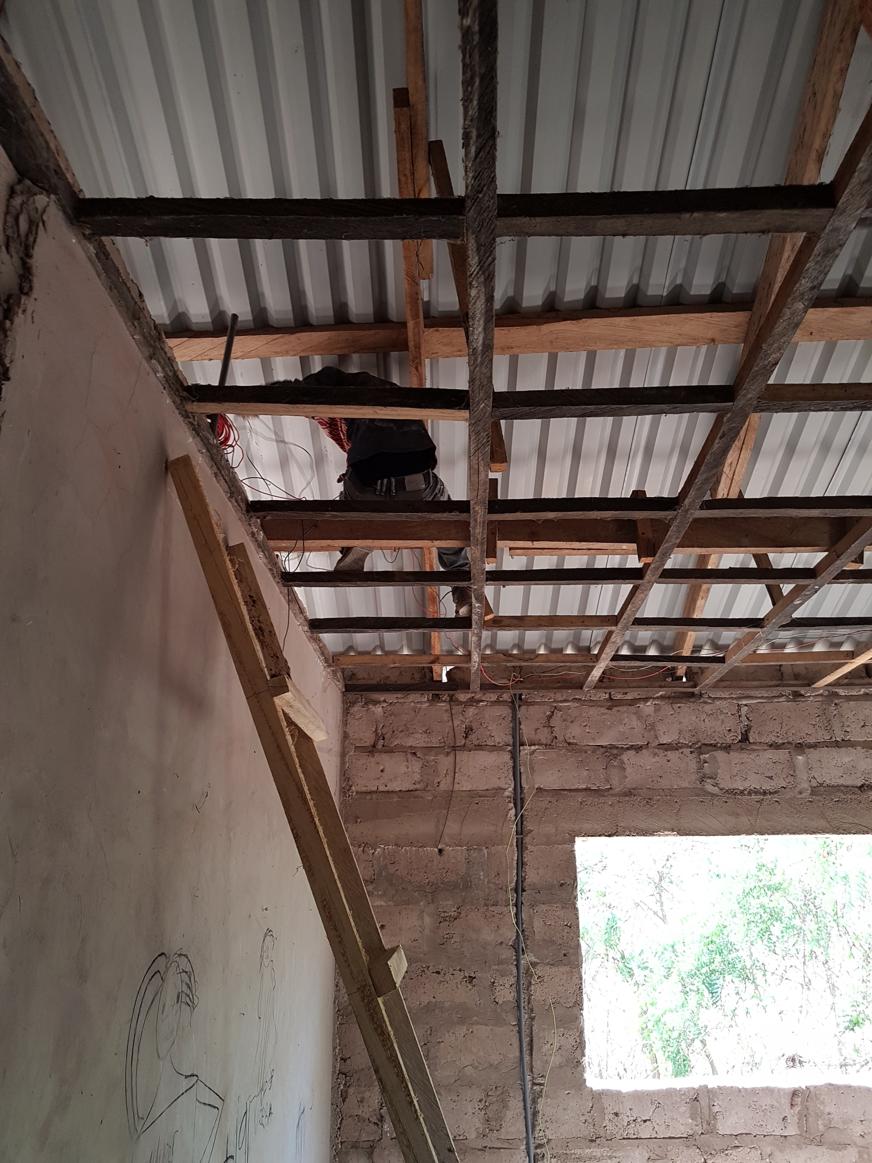 The electrician Mohammed laying out cables